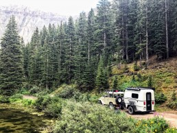 Land Rover driving GoBE camper on backcountry roads