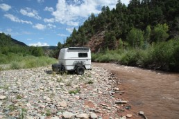 Small camper on gravel road